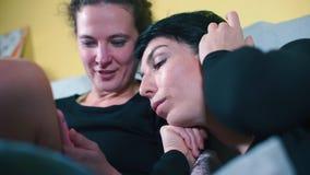 A transgender lies on the shoulder of a same-sex partner.
