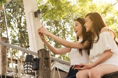 Life of generation Y teenagers hang out in coffee shop use smart Stock Photo