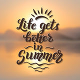 Life gets better in summer. Original summer brush lettering quote on blurred background. For summer posters, t shirts, prints, bags, pillows, home decorations Stock Photo