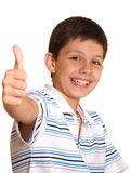 Life is good!. A happy boy is showing his right thumb; isolated on the white background Royalty Free Stock Photo