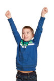 Life is good. Young cute 10 year old white boy with hands in the air smiling expressing joy and victory. Expressions concept Royalty Free Stock Photography