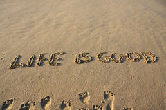 Life is good. Message written on a sandy beach Stock Image
