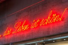 Life is good in German language. `Life is good` in German language as a neon sign close up Stock Photos
