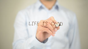 Life is Good , Man writing on transparent screen. High quality Royalty Free Stock Image