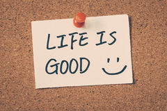 Life Is Good. Note pin on the bulletin board Stock Photo