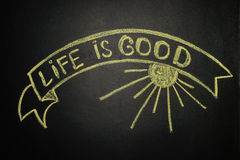 Life is good with Ribbon Banner, written with chalk on a blackbo Stock Photography