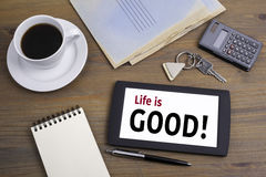 Life is Good! Text on tablet device on a wooden table Stock Photos