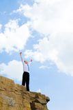 Life is great. Photo of joyful businessman looking at bright sky with his arms raised expressing happiness and enjoyment Royalty Free Stock Photo