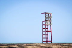 Life guard chair on the beach Royalty Free Stock Photo
