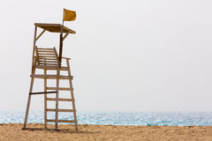 Life guard chair at the beach Stock Images