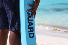 Life guard on duty at beach. Life guard on duty in Nassau, Bahamas beach showing sand and water in the background with focus on word Guard Royalty Free Stock Image