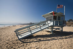 Life guard house on the Santa Monica beach. The life guard house on the Santa Monica Beach - California. The beach is crowded of people, the sea is calm a some Stock Photography
