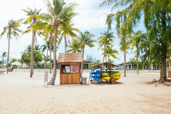 Life guard house on tropical beach with palm trees, blue sky and. White sand Royalty Free Stock Photography