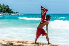 Life Guard installed the No Swimming Red Flag on the beach Stock Photo