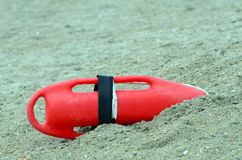 Life Guard Rescue Buoy Life Saving Equipment. Life guard life saving rescue buoy sitting in sand ready to go if needed. A rescue buoy, also called a Burnside Royalty Free Stock Photos