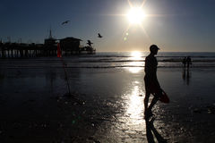 Life guard at Santa Monica Beach. Lifeguard walking on the beach next to Santa Monica Pier royalty free stock photo