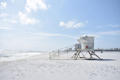 Life guard station on empty beach Stock Images