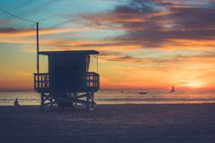 Sunset at Toes Beach. Life guard station silhouetting the warm, colorful sky at sunset on Toes Beach, Playa del Rey, California Royalty Free Stock Image