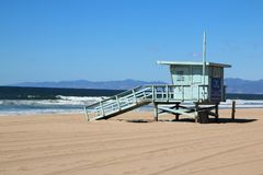 Life guard tower looking towards the sea. Life guard tower on Manhattan beach looking out to the deep blue ocean and surrounded by golden sand Stock Photo