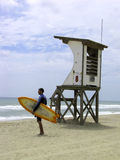 Life guard tower. With surfer boy Royalty Free Stock Image