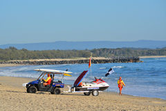 Life Guards setting up. Shot at Noosa Beach, Australia. Life Guards setting up for the day Stock Photography