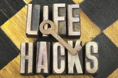Life hacks concept. Made from wooden letterpress type with vintage key on top Royalty Free Stock Photography