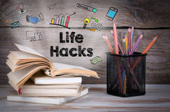 Life Hacks. Stack of books and pencils on the wooden table. Stack of books and pencils on the wooden table Royalty Free Stock Photography