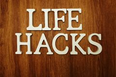 Life Hacks word alphabet letters on wooden background. Top View of Life Hacks word alphabet letters on wooden background stock photography