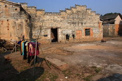 Daily life in Hakka round house Royalty Free Stock Image