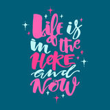 Life is in the here and now concept hand lettering motivation po Stock Images