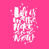 Life is in the here and now concept hand lettering motivation po Stock Photo