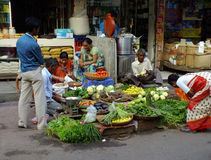 Life in India Mini Market in Colaba. Sellers at a mini vegetable market in Colaba near Mumbai Royalty Free Stock Images
