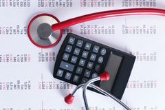 Life insurance concept. Calculator and stethoscope. On bill background Stock Photography