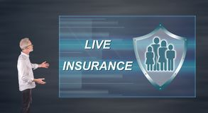 A life insurance concept explained by a businessman on a wall screen. Businessman showing a life insurance concept on a wall screen Stock Images