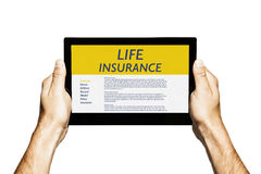 Life Insurance concept. Hands holding a digital tablet with Life Insurance contract in the screen Royalty Free Stock Images