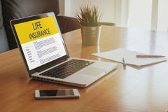 Life Insurance concept. Laptop computer with Life Insurance contract in the screen Royalty Free Stock Images