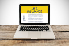 Life Insurance concept. Laptop computer with Life Insurance contract in the screen Royalty Free Stock Photos