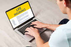 Life Insurance concept. Man typing in a laptop computer with Life Insurance contract in the screen Stock Photos