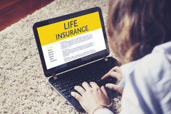 Life Insurance concept. Woman typing in a laptop computer with Life Insurance contract in the screen Royalty Free Stock Image