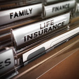 Life Insurance Contract. Close up on a file tab with the word life insurance, focus on the main text and blur effect. Concept image for illustration of family Stock Images