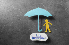 Life Insurance coverage. Paper person under an umbrella with Life Insurance message Stock Photos