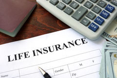 Life insurance  form and dollars. Stock Image