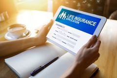 Life insurance online application form on device screen. stock photos