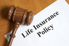 Life Insurance. An insurance policy is an asset for anyone taking care of their loved ones once the final day comes Stock Photo