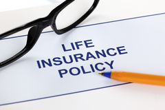 Life insurance policy. With glasses and ballpoint pen Royalty Free Stock Photography