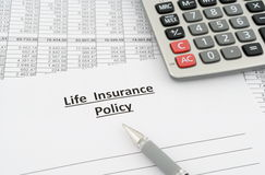 Life insurance policy. With numbers, calculator and pen on table Royalty Free Stock Images