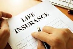 Life insurance policy. Life insurance policy on a table Royalty Free Stock Photos