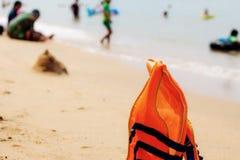 Life jacket on beach. Life jacket on sand beach at the sea stock photo