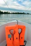 Life jacket in a boat. Life jacket on a boat sailing, at dusk stock photo