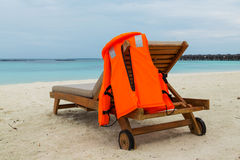 Life jacket on chair Stock Images